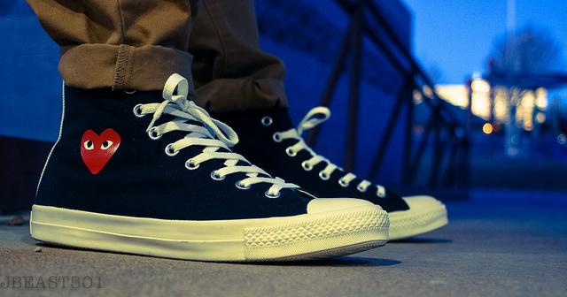 cdg x converse on feet