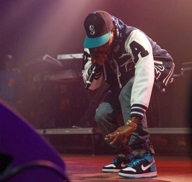 Currensy wearing Nike Dunk High SB Send Help