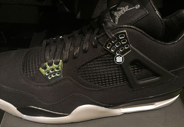 The just-leaked black Eminem Air Jordan 4 is styled with a Carhartt twill  upper 1576d818a