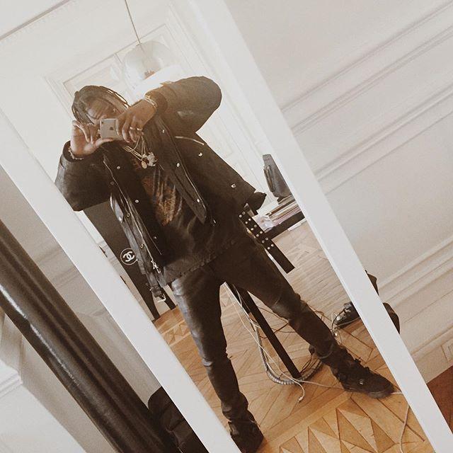 a6dc7c08fcfe05 Travis Scott wearing the  Black Cat  Air Jordan 4