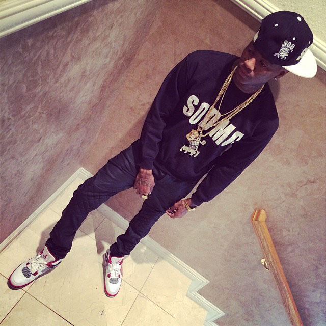 Soulja Boy wearing Air Jordan 4 Retro Fire Red