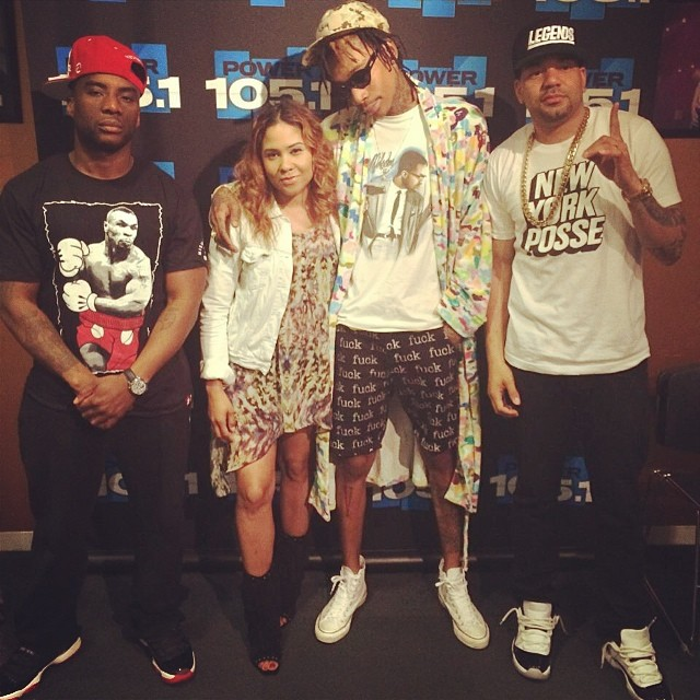 Charlamagne wearing Air Jordan XI 11 Bred; DJ Envy wearing Air Jordan XI 11 Low Concord