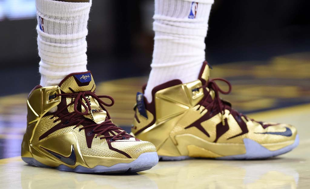 LeBron James wearing a Nike LeBron XII 12 Gold Finals PE