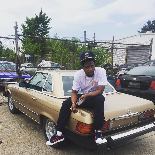 Currensy wearing the adidas Superstar in Navy/Red