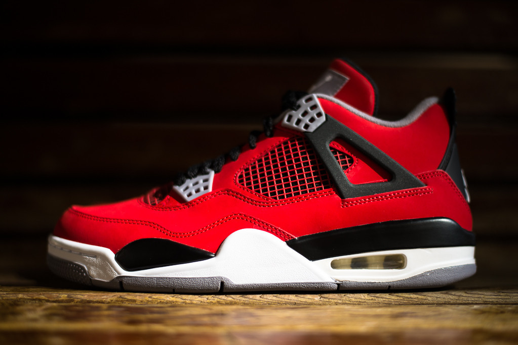 huge selection of 7bd7a bb835 Never not selling, the popular Air Jordan 4 Retro will release tomorrow in  a new Fire Red   White   Black   Cement Grey colorway.