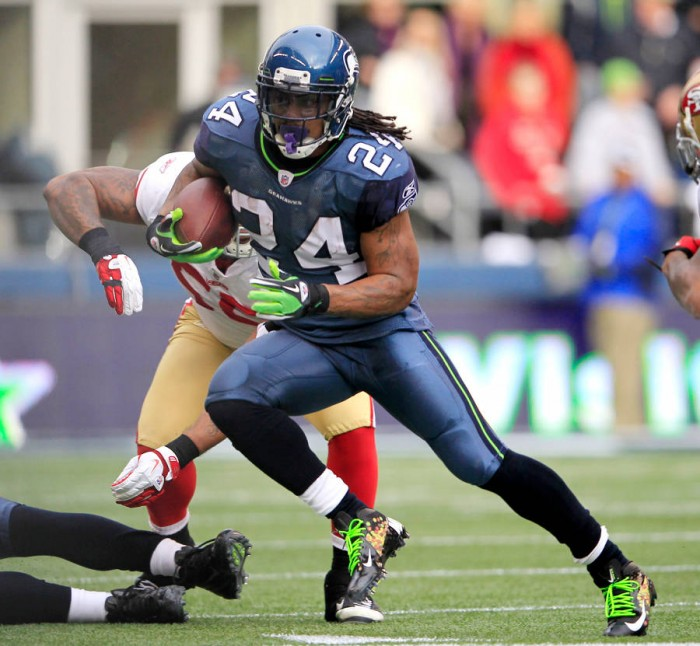 Marshawn Lynch wearing Nike Vapor Talon Elite Skittles (1)