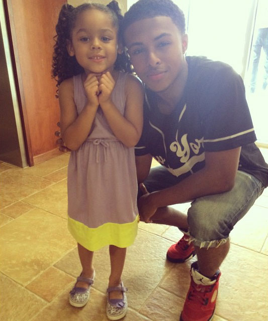 Diggy Simmons wearing Air Jordan V 5 Toro