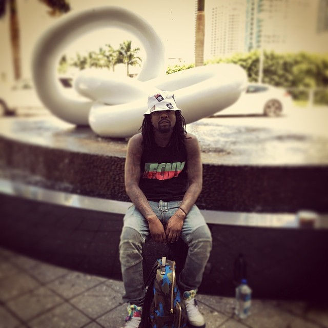 Wale wearing Nike Air Force 180 Union