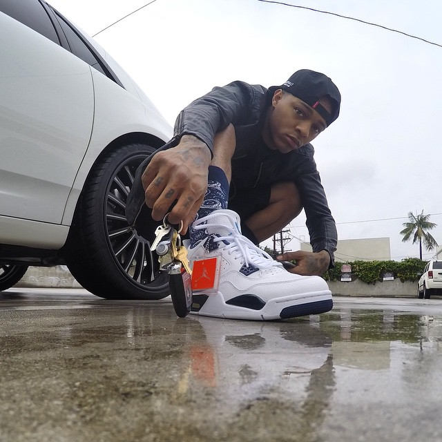 Bow Wow wearing Air Jordan IV 4 Legend Blue