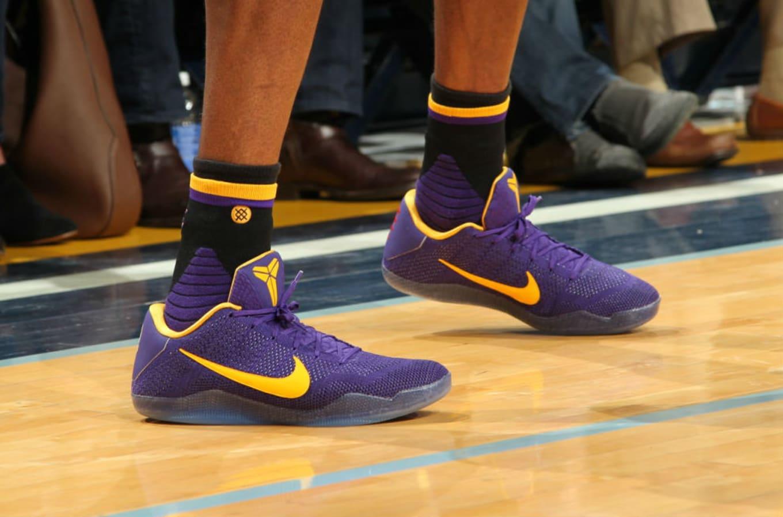 brand new ca410 094da Kobe Bryant Wearing Purple Yellow Nike Kobe 11 PE