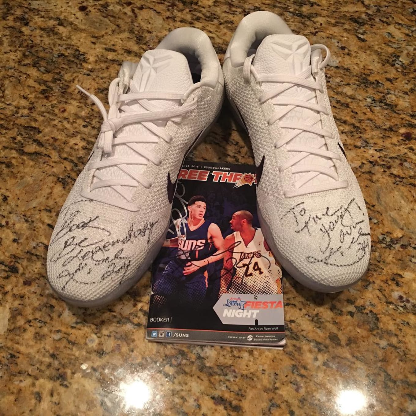 3e474e576b12 Kobe Bryant Gifts Signed Sneakers to Devin Booker