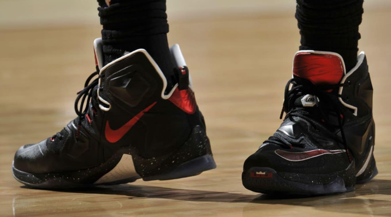 c200e74c3c4 LeBron James Wearing a Black Red-White Nike LeBron 13 PE