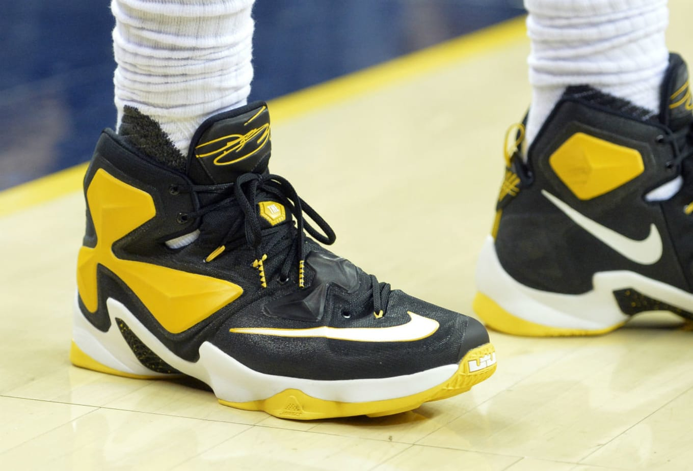 61b9bdac69802 LeBron James Wearing a Black Yellow-White Nike LeBron 13 PE