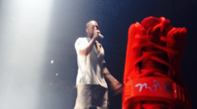2bd1d099226f6 Kanye West Signs Fan s  Red October  Yeezy IIs At Final Yeezus Tour Stop     Video