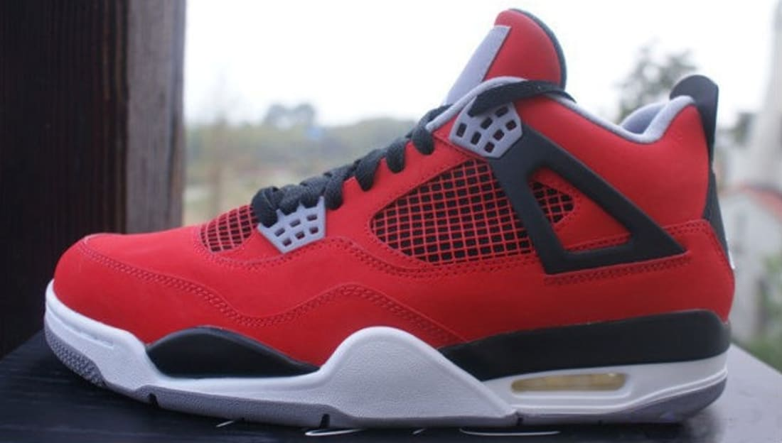 detailed look aadb0 070ed Air Jordan 4 Retro Toro Bravo Fire Red