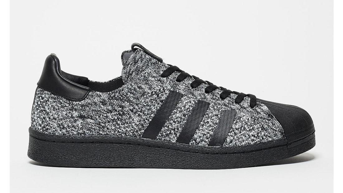adidas superstar black with white sole