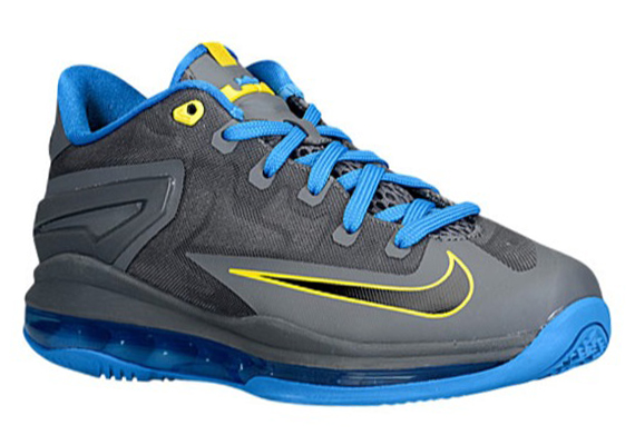 The Dark Grey/Photo Blue-Tour Yellow Nike LeBron XI Low is now available  online via Champs.