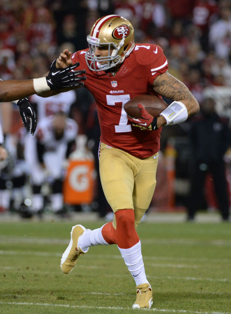 Colin Kaepernick wearing Air Jordan 12 PE Cleats (1)