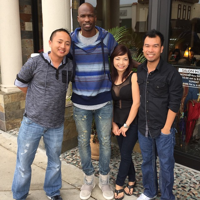 Chad Johnson wearing adidas Yeezy 750 Boost