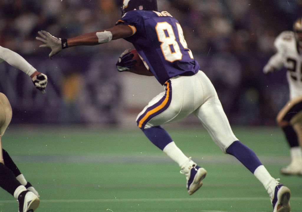 Randy Moss wearing Air Jordan XI 11 Vikings PE (1)