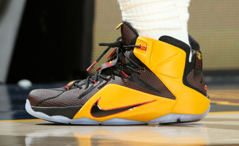 3e8e0f26111 via NBA · LeBron James wearing a Black Yellow-Red Nike LeBron XII 12 PE
