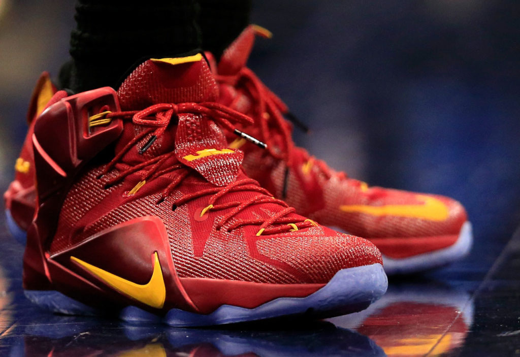 LeBron James wearing Nike LeBron XII 12 Red/Yellow PE on November 21, 2014