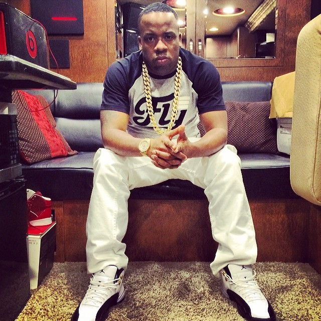 Yo Gotti wearing Air Jordan 12 Taxi