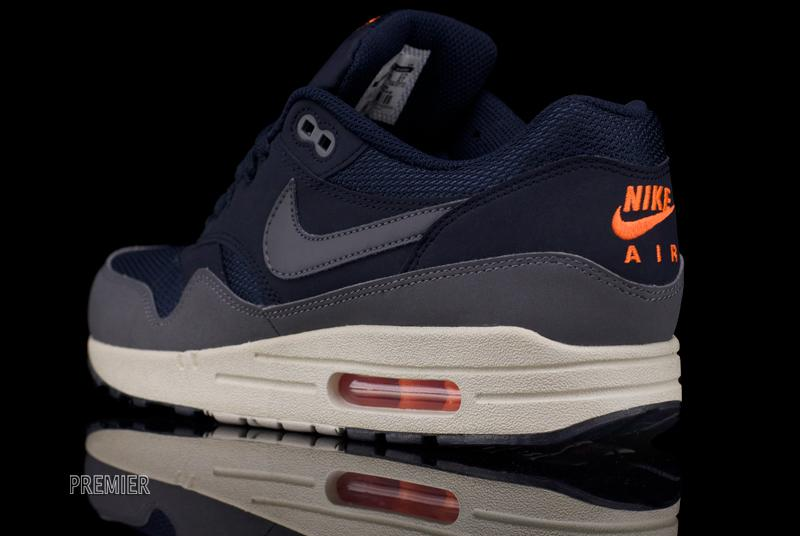fc522e0424ad The Nike Air Max 1 Essential in Dark Obsidian   Dark Grey   Light Bone    Total Orange is available now at Nike Sportswear retailers