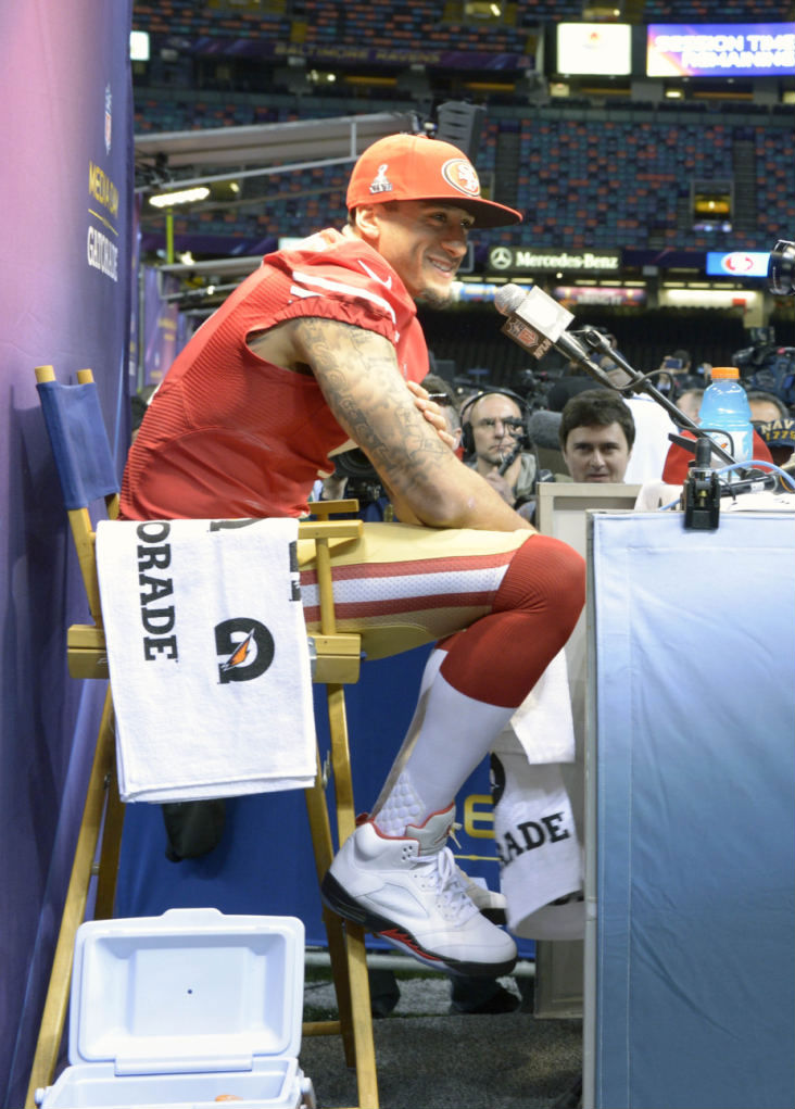 Colin Kaepernick wearing Air Jordan V 5 Fire Red