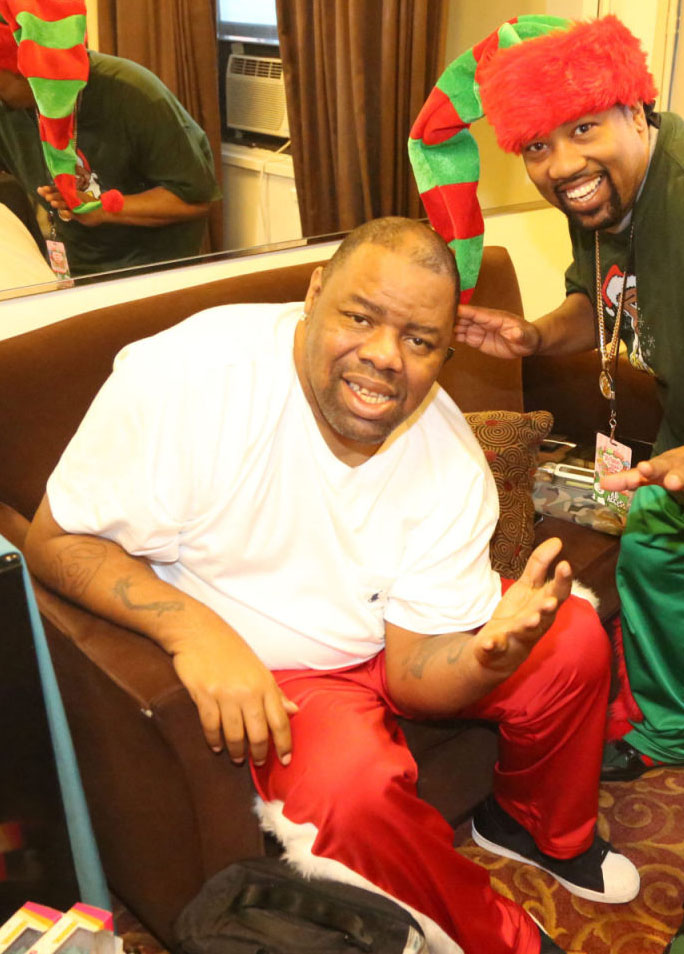 Biz Markie wearing Run DMC x Keith Haring x adidas Originals Superstar 80s Christmas in Hollis