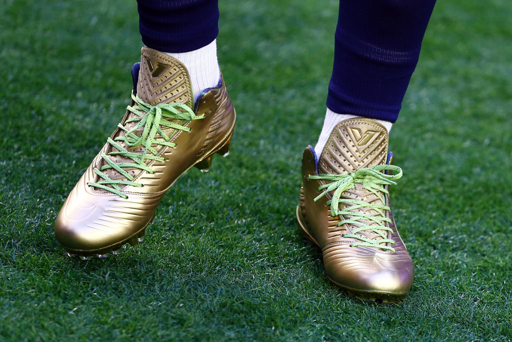 Marshawn Lynch wearing Gold Nike Vapor Speed Cleats for Super Bowl Warm-Ups (2)