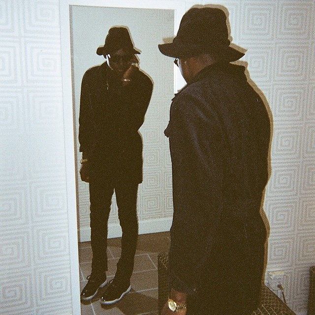Theophilus London wearing Air Jordan 11 Black Red