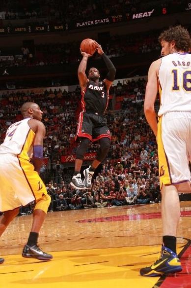Chris Bosh gets the dunk in the Nike Air Max Hyperdunk 2010. Dwyane Wade  gets the shot off in the Air Jordan 2011. cd98820b98