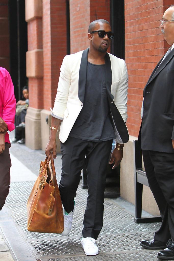 Kanye West wearing adidas Rod Laver Vintage