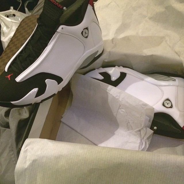 B.o.B. wearing Air Jordan XIV 14 Black Toe