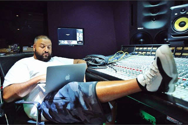 DJ Khaled wearing the White/Black Air Jordan 11 Low IE