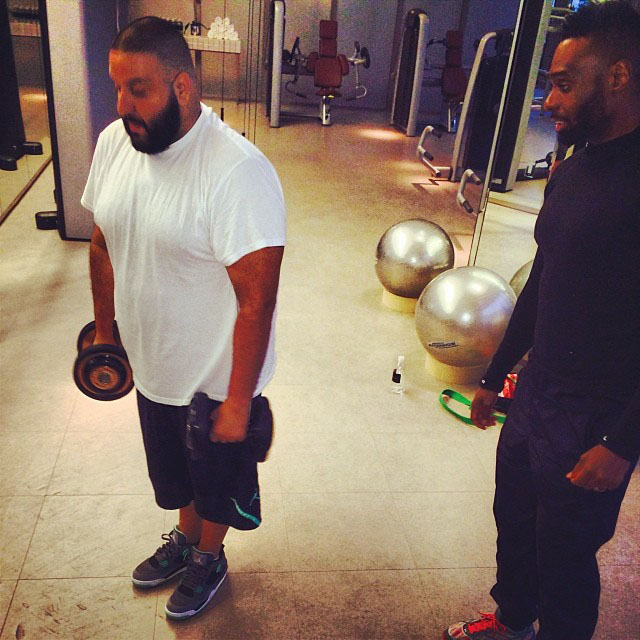DJ Khaled wearing Air Jordan 4 Retro Green Glow