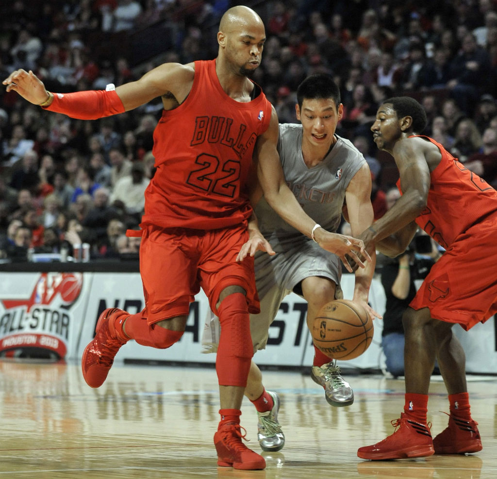 Taj Gibson wearing adidas Rose 773 Light; Marquis Teague wearing adidas Crazy Fast