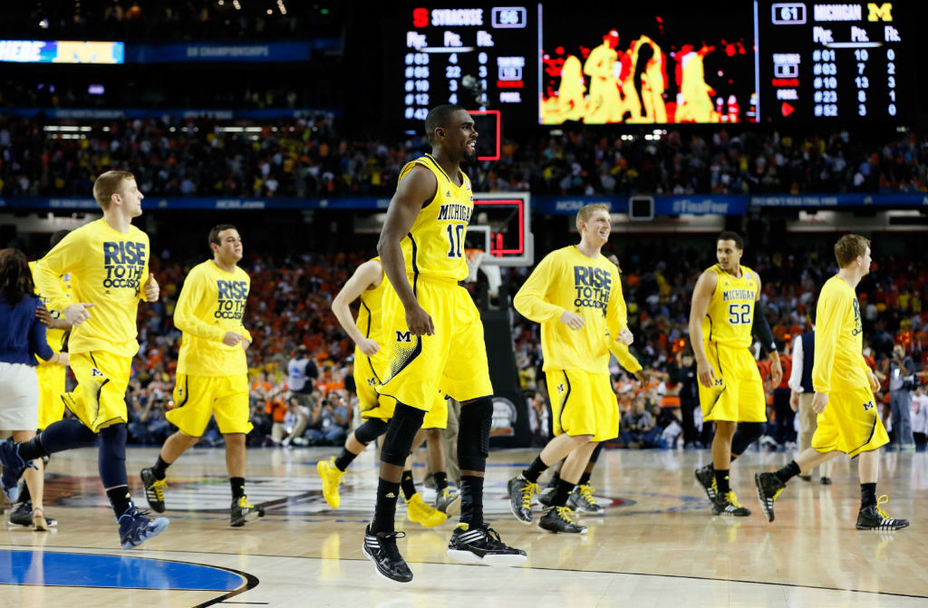 Michigan Wolverines wearing adidas Basketball