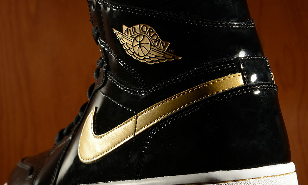 promo code f6c92 8a801 Air Jordan Retro 1 High OG - Black/Gold Patent - Footaction ...
