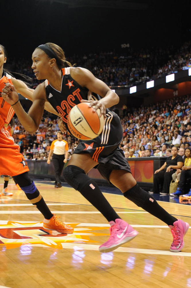 Tamika Catchings wearing Nike Zoom Hyperdisruptor Pink