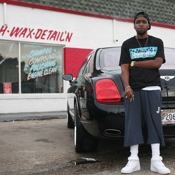 Curren$y wearing Nike Air Force 1 Mid