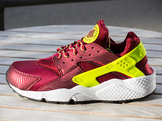 The Team Red/Volt Nike Air Huarache is now available online via Titolo.