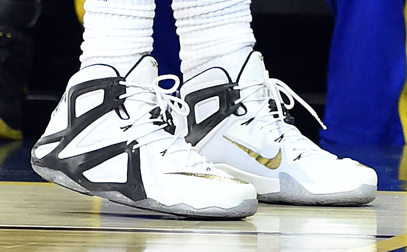 LeBron James wearing a White/Black-Gold Nike LeBron XII 12 Elite PE