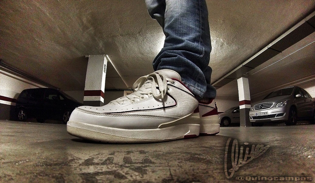 Quino in the White/Red Air Jordan II 2 Retro Low