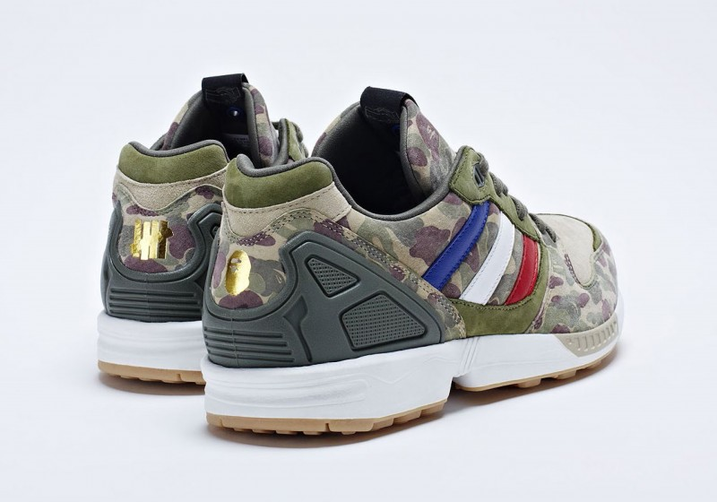reputable site 8e0a6 f2979 The triple branded sneaker features BAPE camo running throughout the upper,  along with metallic gold BAPE and Undefeated branding on the heel.