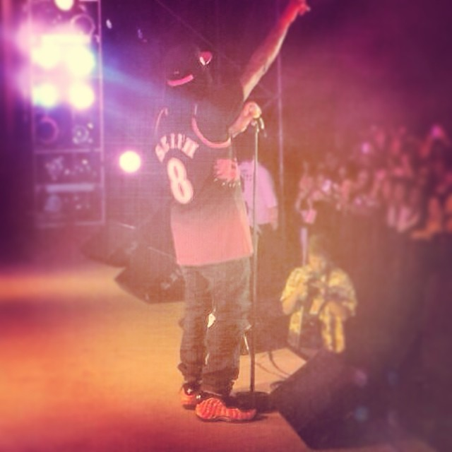 Wale wearing Supreme x Nike Air Foamposite One Red