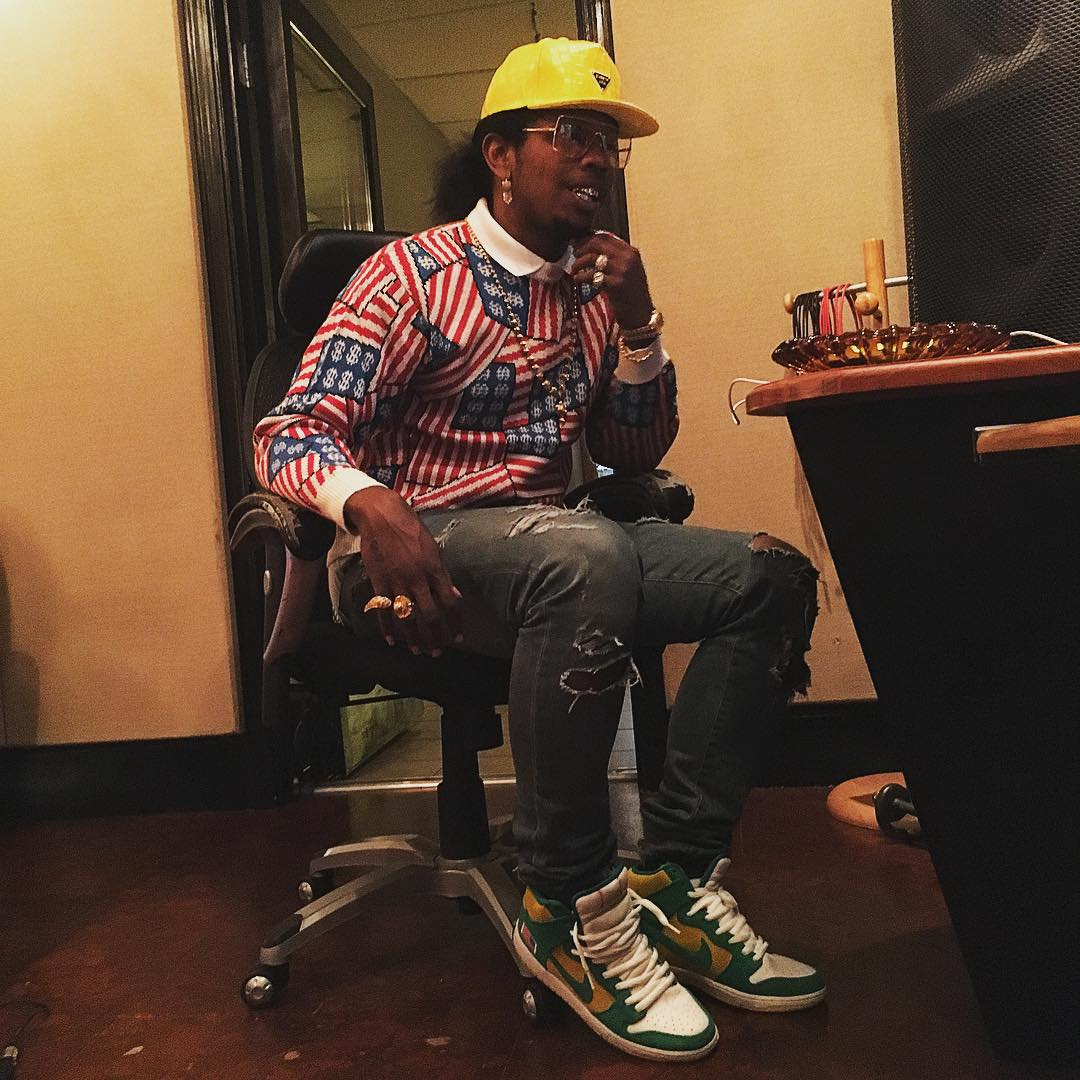 Trinidad James wearing the 'Oakland' Anonymous x Unheard Of x Nike SB Dunk High