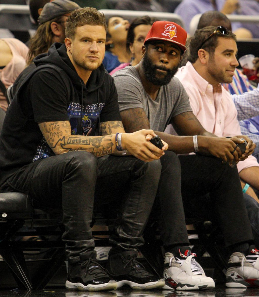 John Geiger wearing Air Jordan 11 XI Retro Space Jam; Darrelle Revis wearing Air Jordan 8 VIII Retro Bugs