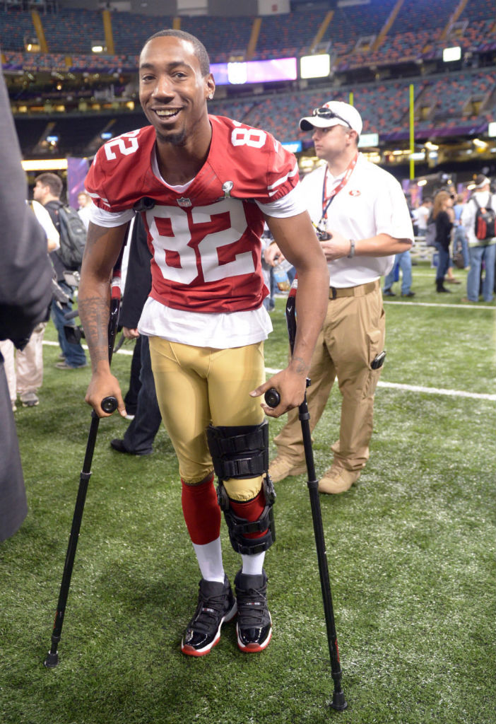 Mario Manningham wearing Air Jordan XI 11 Black Red